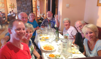Go West tour group enjoying delicious dinner in Ireland