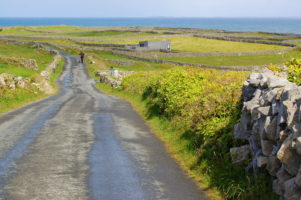 Irish country road, Inis Mor, Aran Islands, Go West tour, Ireland